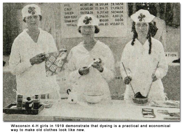 Wisconsin 4-H girls in 1919 demonstrate that dyeing is a practical and economical way to make old clothes look like new.